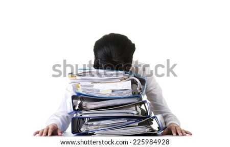 Exhausted businesswoman with a lot of documents - stock photo
