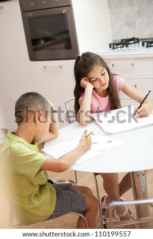 Exhausted children doing their homework