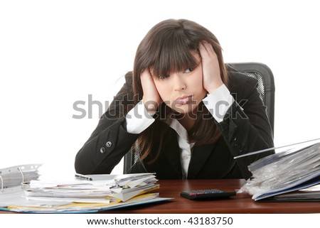 Exhausted female filling out tax forms while sitting at her desk. Isolated - stock photo