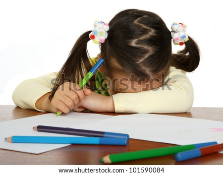 Exhausted girl at his table. isolated - stock photo