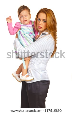 Exhausted mother businesswoman holding  crying girl isolated on white background - stock photo