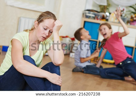 exhausted mother frustrated and upset from children behaviour - stock photo