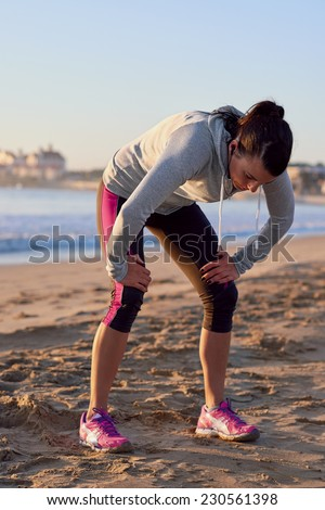 exhausted runner after fitness running workout catching breath - stock photo