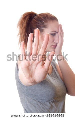 Exhausted woman showing stop hand isolated on a white background - stock photo