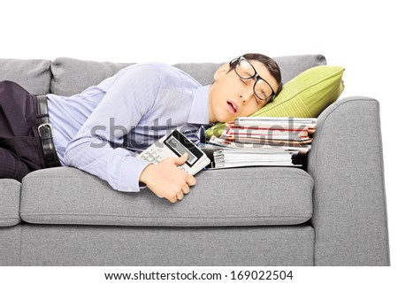 Exhausted young businessman sleeping on a couch with many document, isolated on white background - stock photo
