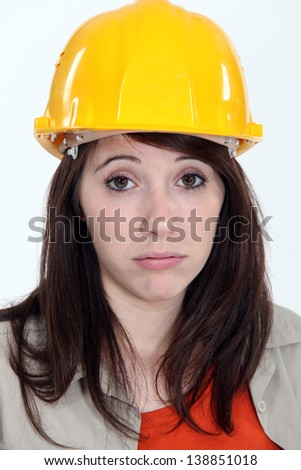 Exhausted young female builder