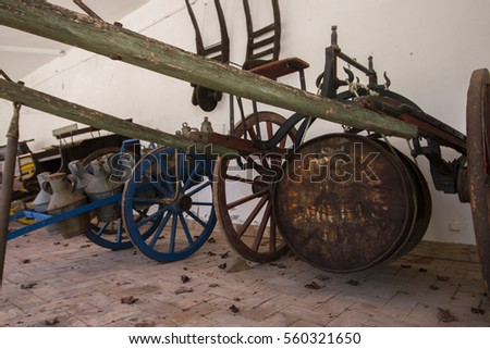 Exhibit of old transport carts in a museum of Sao Bras de Alportel, Portugal.