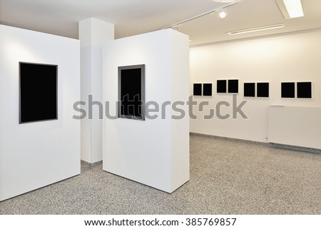 exhibition gallery, wall mounted art with museum style lighting, the art has been removed and replaced. There are path for the frame