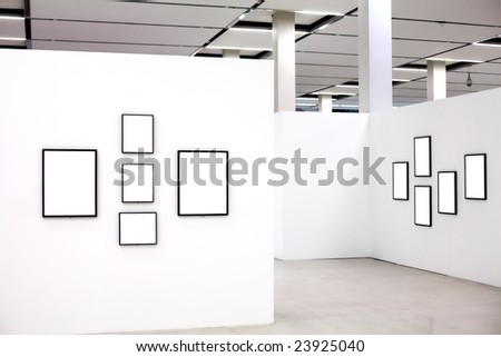 Exhibition in museum with many empty frames on white walls - stock photo