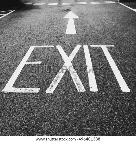 EXIT and arrow painted on road