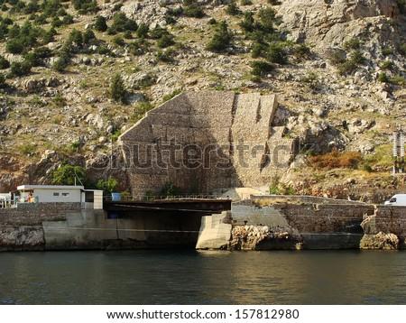 Exit from secret underground submarine base, Balaklava Bay, Crimea, Ukraine - stock photo