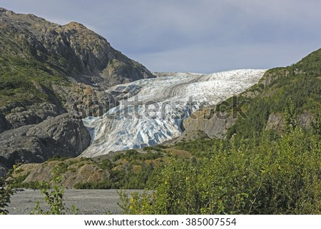 Exit Glacier Coming out of the Mountains near Seward, Alaska - stock photo