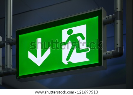 Exit Sign in an Airport Terminal - stock photo