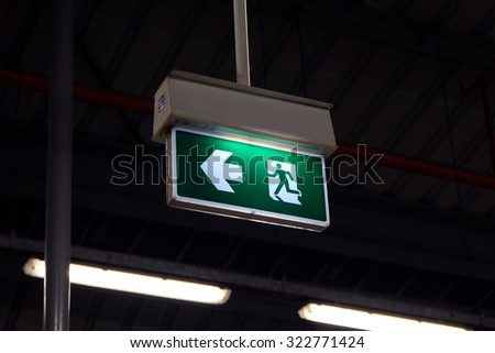 Exit sign light hanging - stock photo