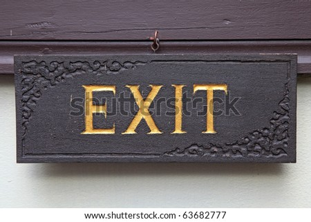 Exit sign on Antique wooden board
