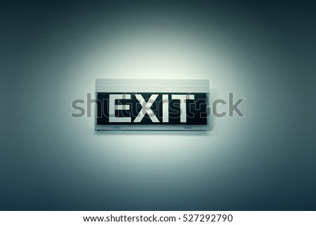 Exit sign on white wall, symbol