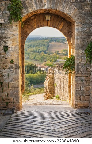 Exit the town of Monteriggioni with views of the Tuscan landscape - stock photo