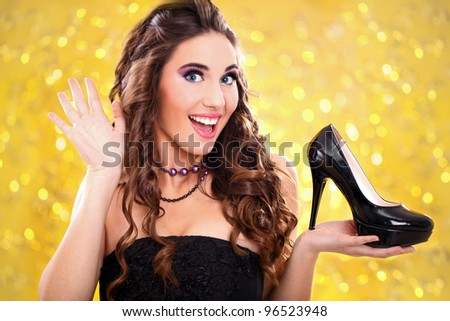 exited girl with her new  high heels - stock photo