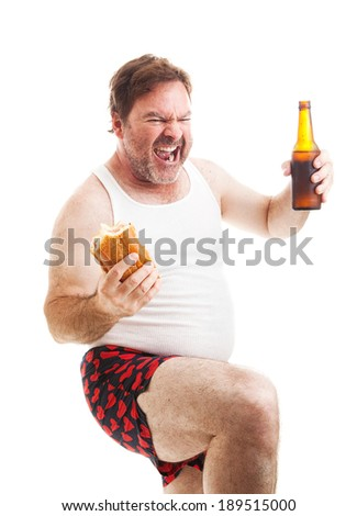 Exited middle aged man in his underwear, watching the game on tv.   - stock photo