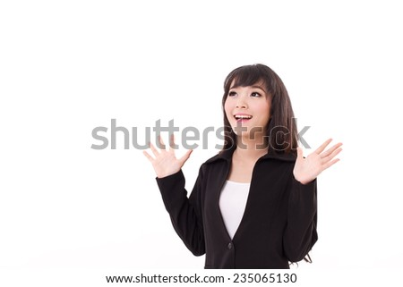 exited, surprised young business woman looking up to blank space - stock photo