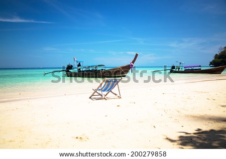 Exotic beach holiday background with beach chair - Thailand ocean landscape - stock photo