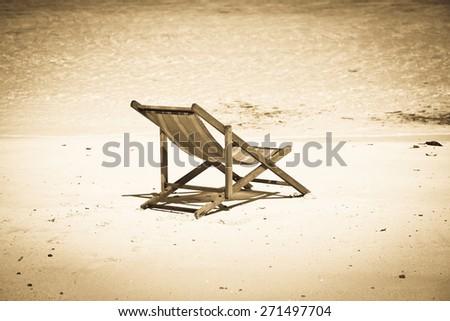 Exotic beach holiday - vintage photo - stock photo