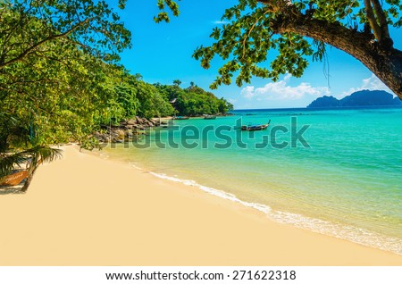 Exotic beautiful beach with white sand and blue ocean, The Phi Phi Islands, Thailand - stock photo