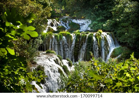 Exotic; beautiful waterfall in a deep forest - stock photo