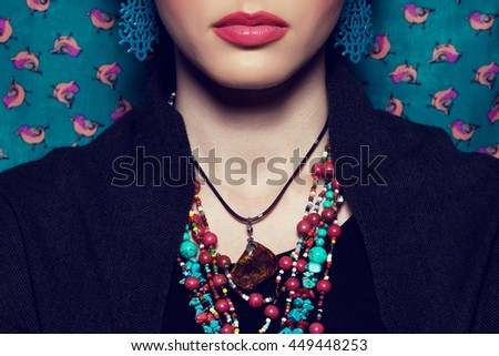 Exotic beauty concept. Beautiful young woman with bright make-up looking like well known Mexican artist posing over vintage background. Luxurious accessories. Retro style. Close up. Studio shot
