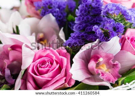 exotic bouquet with orchid and pink rose closeup - stock photo