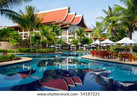 Exotic building and swimming pool with reflection. Tropical resort. - stock photo