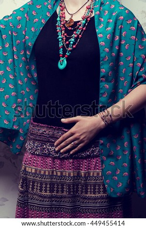 Exotic clothes concept. Woman in bright national clothing like well known Mexican artist posing over vintage background. Luxurious accessories. Retro style. Studio shot