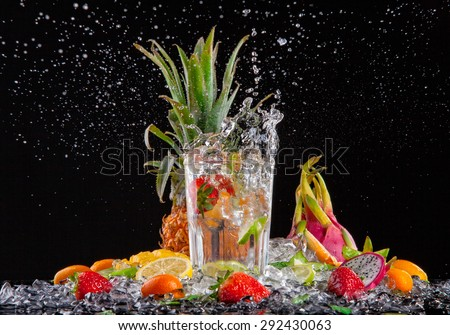 Exotic drink with splash, isolated on black background
