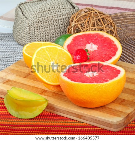 Exotic Fruit on wooden board. grapefruit,carambola and orange slices