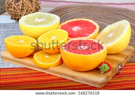 Exotic Fruit on wooden board. grapefruit,pomelo and orange slices