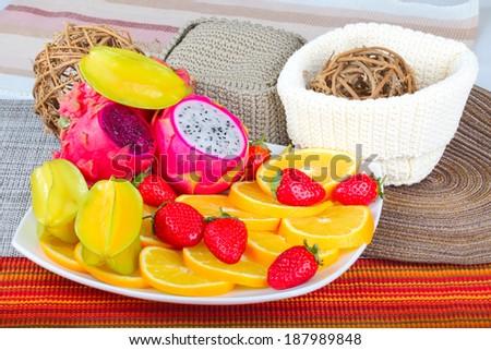 Exotic Fruits Dish with Dragon Fruit, pitahaya,strawberri es and orange slices  - stock photo
