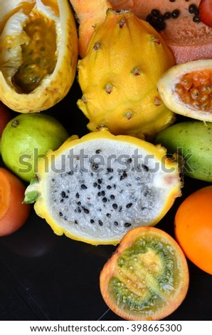 exotic fruits set with yellow dragon fruit in the centre - stock photo