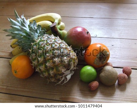 Exotic fruits variety still life on a rustic wooden table