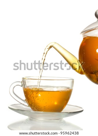 exotic green tea with flowers in glass teapot and cup isolated on white - stock photo