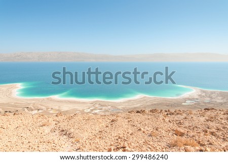 Exotic landscape in desert Dead Sea shoreline aerial view with range of high mountains on opposite shore - stock photo