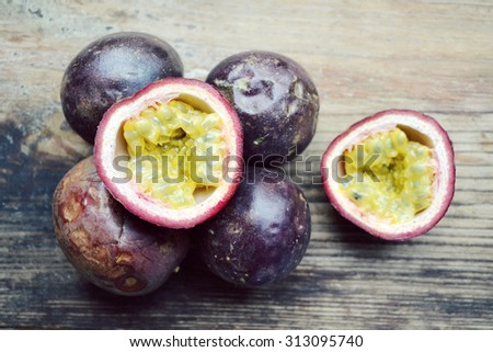 Exotic passionfruit on a wooden table - stock photo