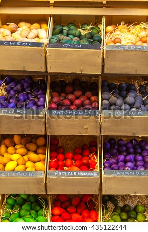 Exotic scented wooden balls for sale in French marketplace. Scents titles in French