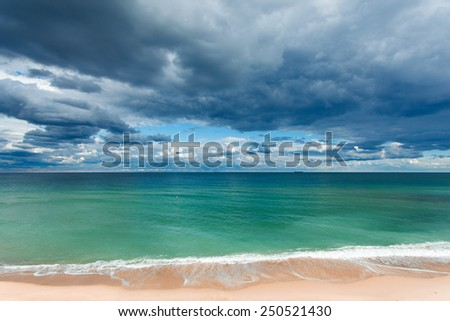 exotic tropical beach, golden sand and beautiful clouds