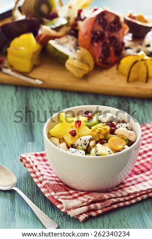 Exotic Tropical Fruit Salad with Chopped Fruit on Cutting Board