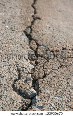 Expand crack on the cement road. - stock photo