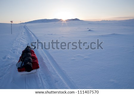 Expedition Sledge at Sunset on the Kungsleden hikingtrail in Lapland