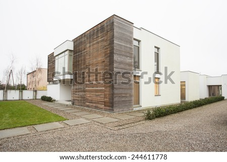 Expensive and designed house from the outside - stock photo