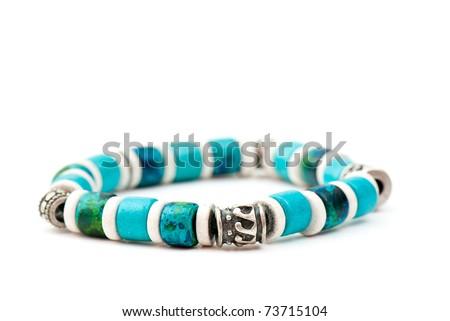 Expensive beautiful bracelet on the white isolated background - stock photo
