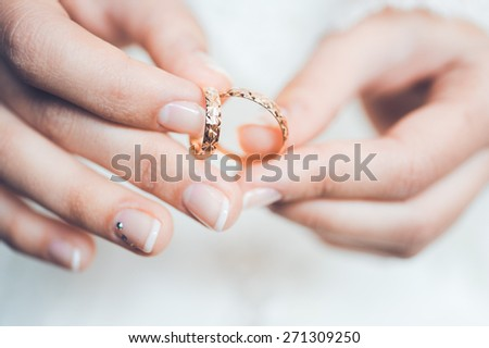 expensive, beautiful wedding ring with diamonds in the hands of a girl