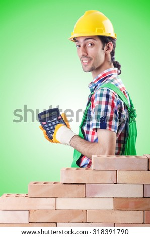 Expensive construction concept with builder and calculator - stock photo